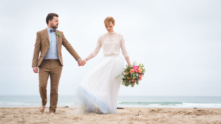 yorkshire wedding photographer with a couple on the beach