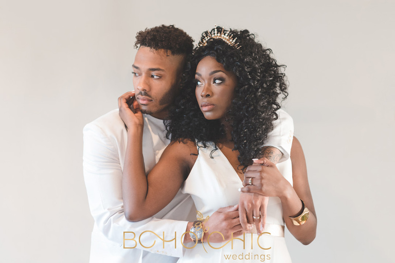 contemporary photograph of a wedding couple dressed in chic white