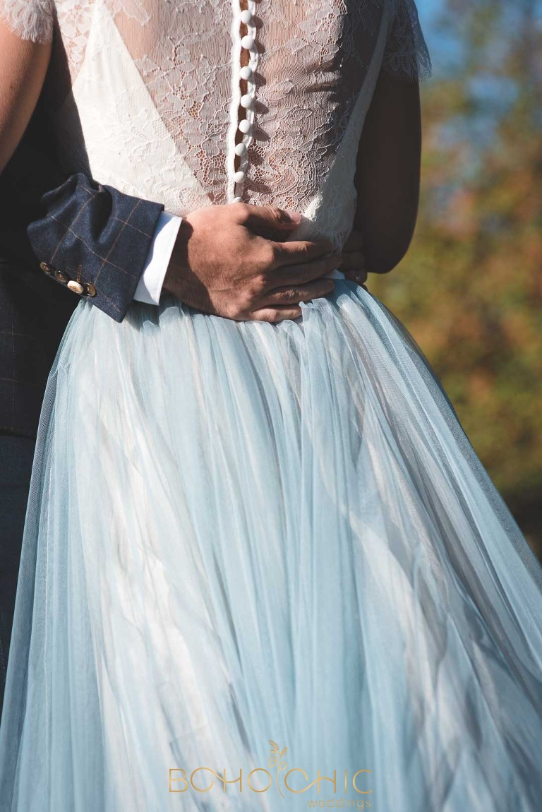 chantel lauren wedding dress in marbled blues and green with a cream lace top
