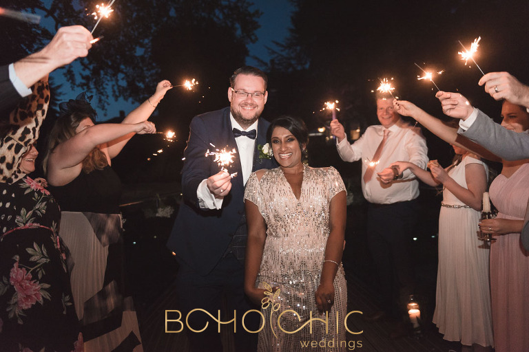 bowcliffe hall wedding photograph of a couple enjoying a sparkler walk in the blackburn wing