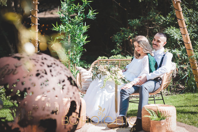 wedding couple looking very in love relaxing at their festival style wedding