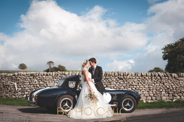 yorkshire dales wedding photographer showing a picture of a young couple by an A C Cobra