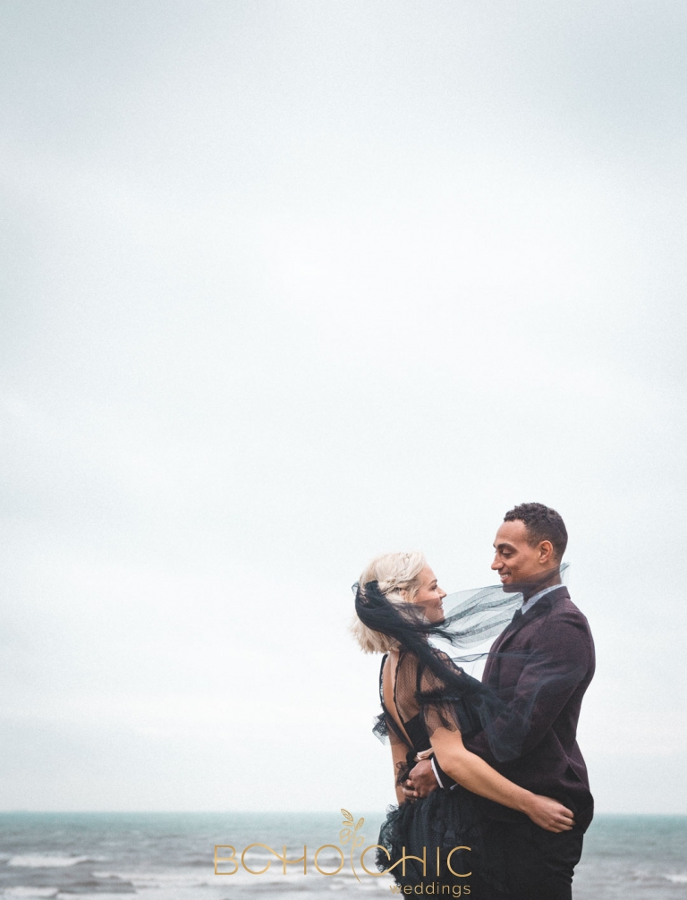 a very beautiful couple wearing black for their wedding at a coastal wedding venue in yorkshire at robin hoods bay
