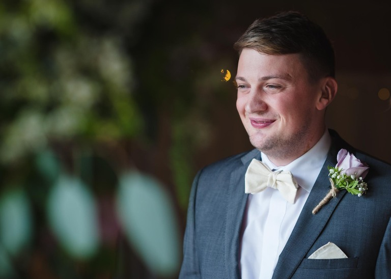 groom wearing a pale lemon bow tie photographed by leeds wedding photographer Catherine Kerr