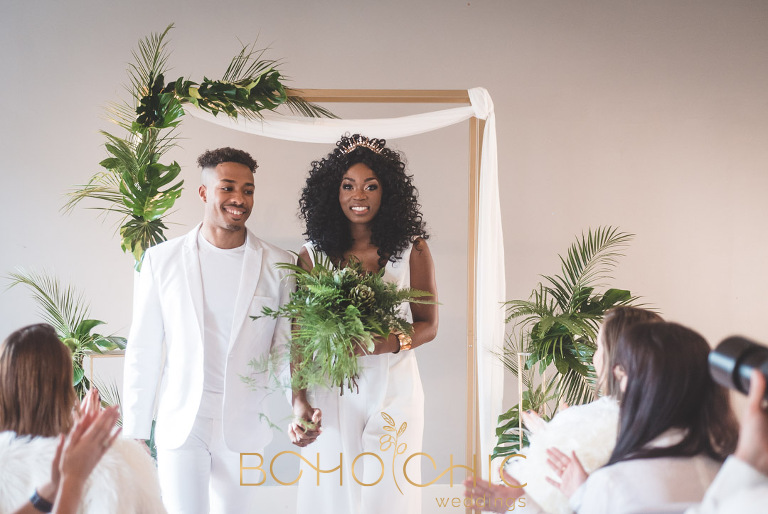 an African couple both dressed in white for their chic city wedding in Manchester