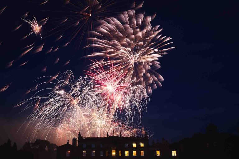 a colour photograph of brilliant fireworks at Broughton Hall Skipton wedding photographed by Yorkshire wedding photographer