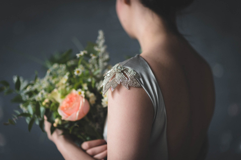 grey silk wedding dress with beading on the shoulder