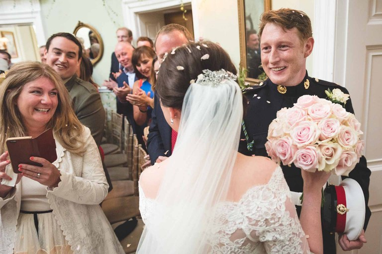 reportage photograph of a couple who have just walked down the aisle at Middleton Lodge in North Yorkshire