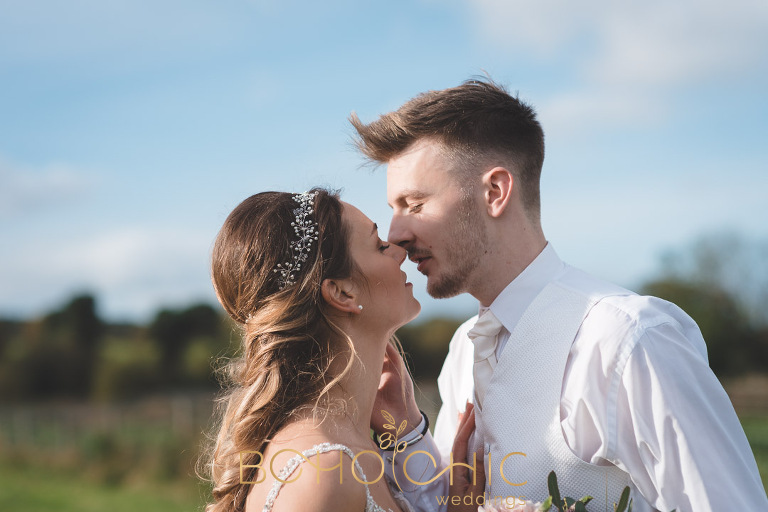 young wedding couple about to kiss at their yorkshire barn wedding