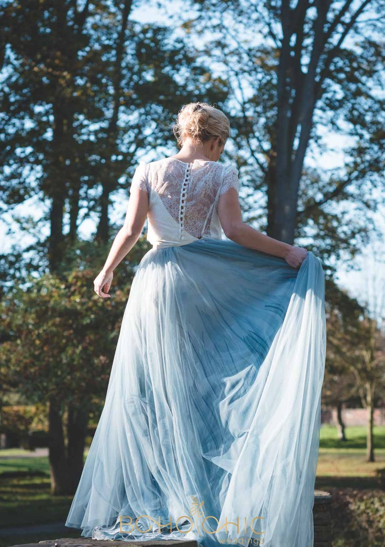 bride in the yorkshire countryside wearing chantel lauren wedding dress in marbled blues and green with a cream lace top