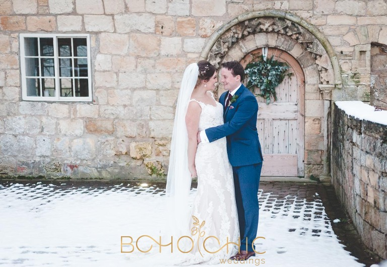 priory cottages wedding photography showing the bride and groom in the snow