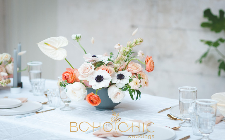 winter wedding table setting with flowers in orange peach and white