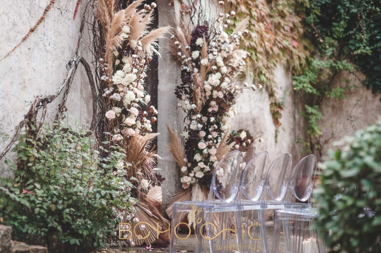 stunning soft rose and cotton bud autumn floral styling around an arch at a majorca wedding venue