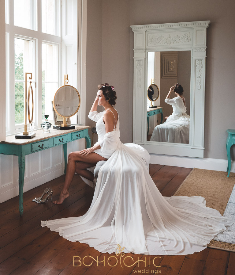 thicket priory wedding photography in the bridal suite showing bride at the dressing table